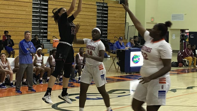 In a game from last month, Palm Beach Lakes junior Zaida Gonzalez, left, shoots a jumper against Palm Beach Gardens. Gonzalez had 15 points, four steals and four assists in Saturday's win over Lincoln Park Academy.