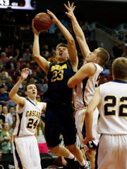 Drew Cook of Regina drives to the basket in the 2A quarterfinal win Tuesday against Cascade at Wells Fargo Arena in Des Moines.