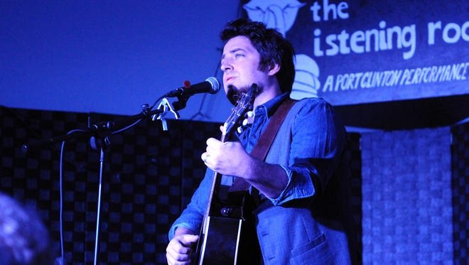 Lee DeWyze, singer-songwriter and winner of the ninth season of American Idol, performs the first of two sold-out shows at the Listening Room in downtown Port Clinton on Friday night.