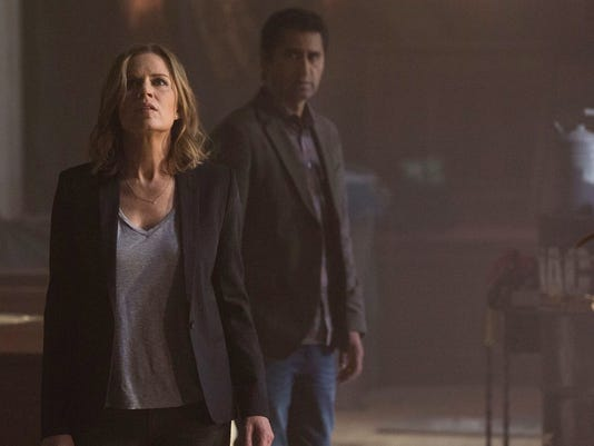 "Kim Dickens and Cliff Curtis are seen in a still from ""Fear the Walking Dead.""  (Courtesy of AMC)"