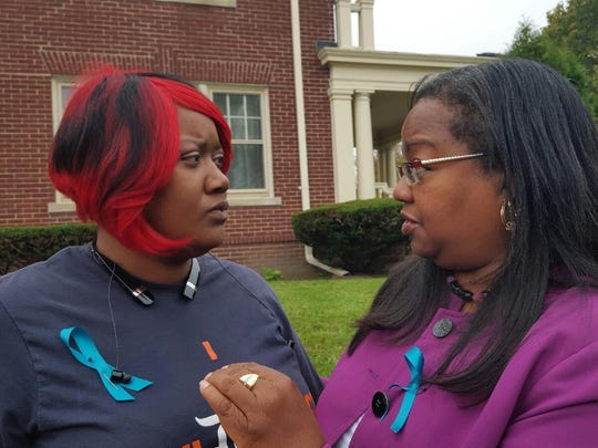Ericka Murria, 32, talks with Wayne County Prosecutor Kym Worthy Tuesday in Detroit about her own rape 11 years ago. Hers was among the lost rape kits. Her assailant was not found in the national DNA database known as CODIS. Later, she and Worthy exchanged a hug.