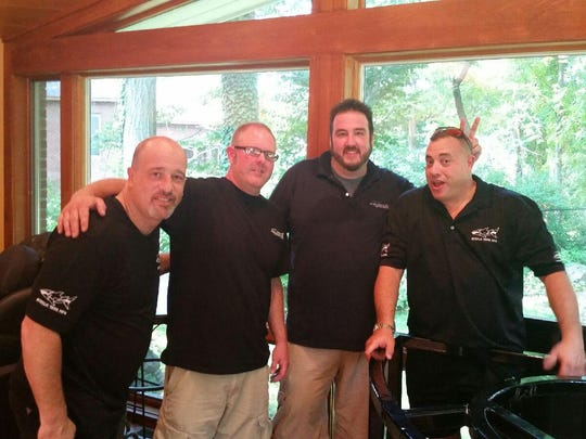 "Aquaholics Jim Frint and Ryan Frei (near left and right) filmed a recent episode of Animal Planet's ""Tanked"" with Brett Raymer and Wayde King."