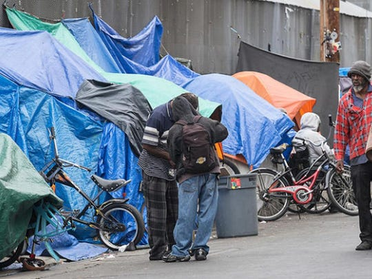 Homeless people set up tarps and tents in downtown Los Angeles in May 2016.
