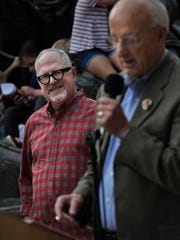 "Author William Joyce listens to former Abilene Mayor Gary McCaleb speak about the first time he read Joyce's book, ""Santa Calls,"" which features the Key City, Saturday Oct. 21, 2017. Behind them, children climb a statue in Everman Park based on the book. Joyce has released a new edition of the book with updated illustrations and brighter colors."
