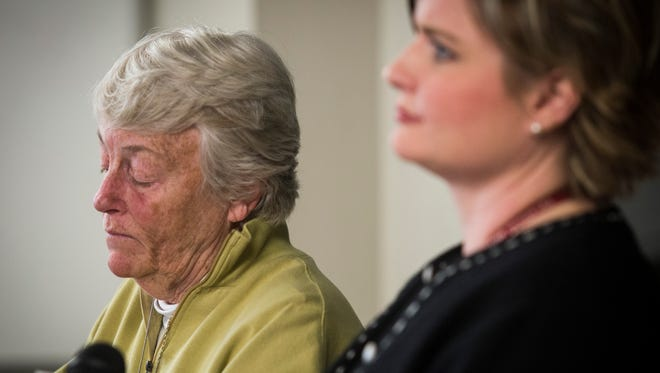 From left, Burlington College President Carol A. Moore listens as Coralee Holm, dean of operations and advancement, announces the school will close its doors at the end of the month during a news conference held Monday, May 16, 2016.