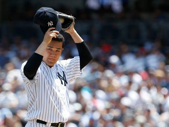 Yankees starter Masahiro Tanaka pauses before delivering