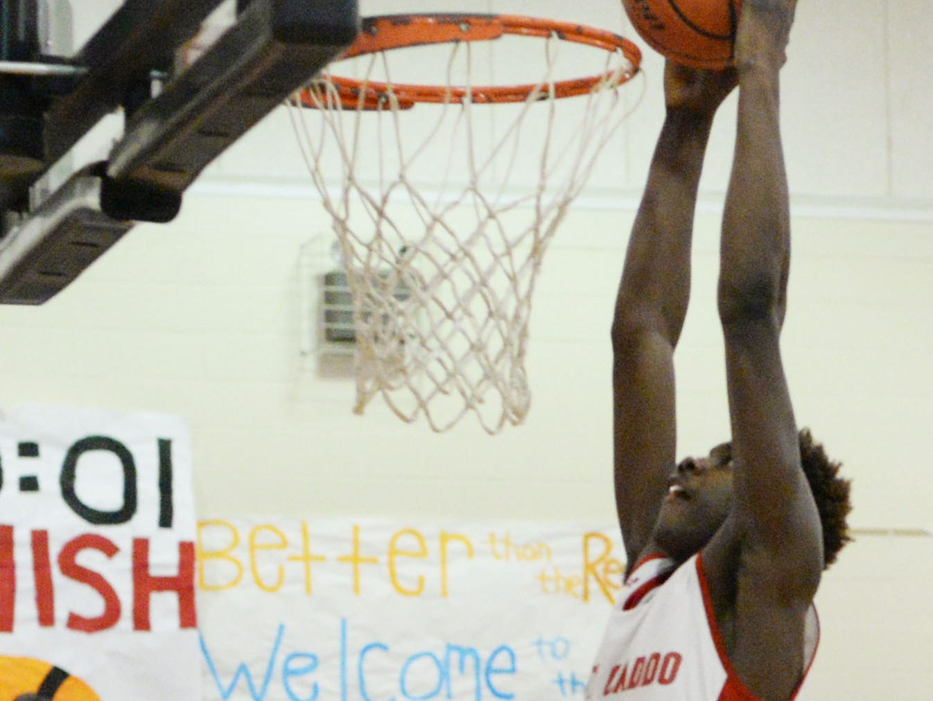 North Caddo's Chris Thomas goes up for a dunk in a 69-47 quarterfinal win over Episcopal last Friday.