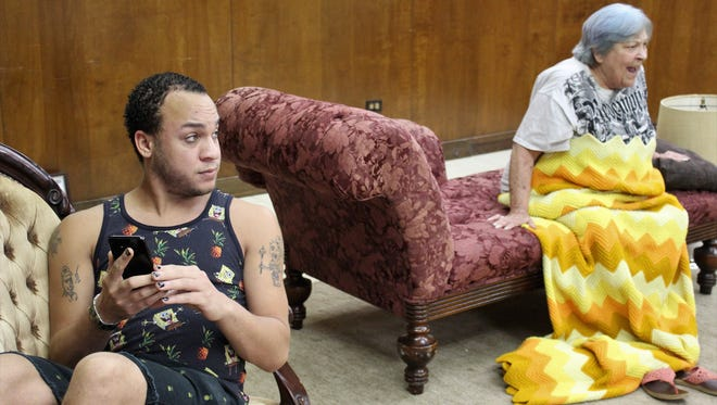 """Adrian Johnson's Justin is on his cellphone while talking with his mother, Grace, (Karen Reese) in this rehearsal scene for """"The Door,"""" one of four one-act plays on the Abilene Community Theatre Black Box Theatre stage Thursday through Saturday."""