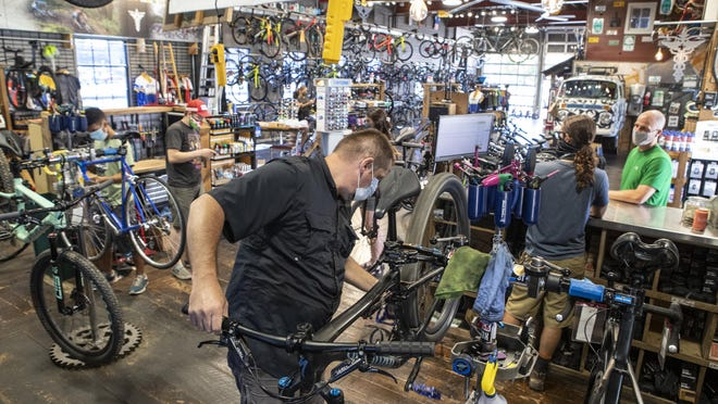 "Bike Surgeon's Mike ""Big Mike"" Eschmann works on a customer's bike in the service area. The Bike Surgeon, located in O'Fallon, Illiniois, has been busy since COVID-19 hit the region."