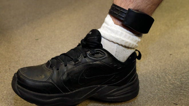 A GPS tracking device on a man's leg.