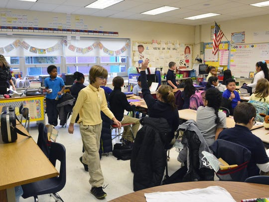 Mrs. Earhart (left) and her fourth grade class are