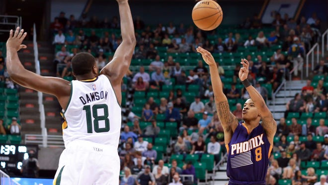 Oct 12, 2016; Salt Lake City, UT, USA; Suns guard Tyler Ulis shoots a jump shot over Jazz forward Eric Dawson  during the fourth quarter at Vivint Smart Home Arena. Phoenix Suns beat the Utah Jazz 111-110.