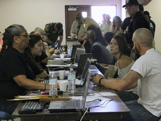 The Otero County Sheriff's Office processed 40 people arrested on warrants Friday morning at the Otero County Fairgrounds.