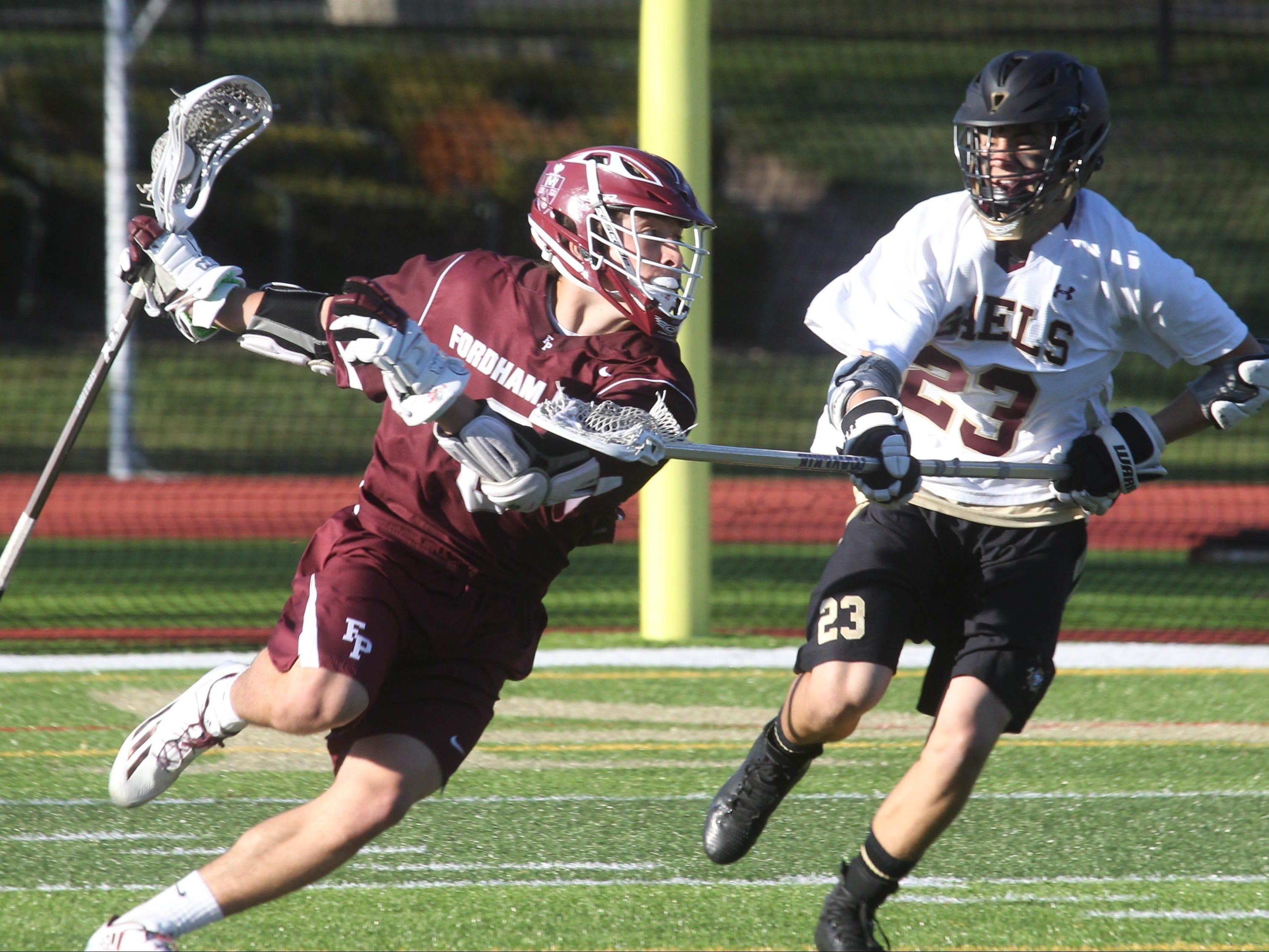 Fordham Prep's Andrew Abbattista is pressured by Iona Prep's Jack Cleary during their game at Iona Prep April 15, 2016. Fordham Prep won 8-7.