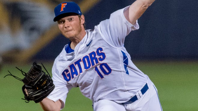 Florida's A.J. Puk pitches against LSU during a Southeastern Conference baseball tournament game Wednesday in Hoover, Ala.