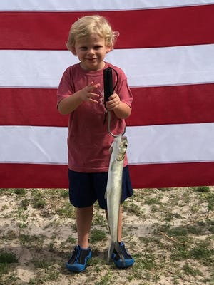 Local angler Hayden Phillips weighing in his catch at the recent AHERO Fishing Rodeo.