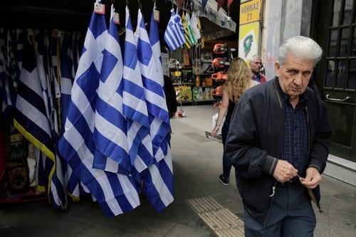 Greece under pressure as deadline looms, Teva May up stake in Mylan
