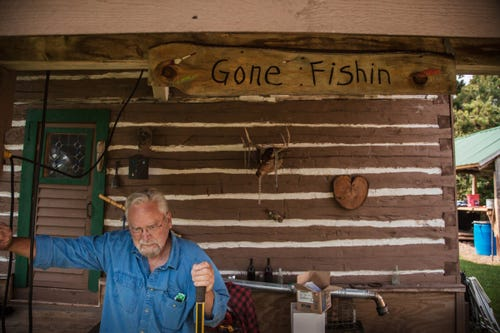 Jim Vivian, 74, stands on the front porch of his small wood cabin in the defunct mining town of Central, Mich., where he's the lone resident.