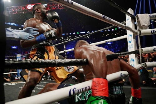Deontay Wilder escapes KO, then KOs Luis Ortiz in the 10th round