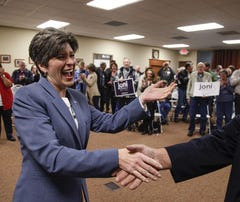 Ernst keeps low profile on her way to history
