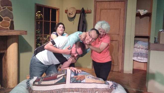 """Left to right: Sarah Zimmermann, Adam Bish, Duane Bull and Heidi Hormel act out a scene from """"Weekend Comedy."""""""