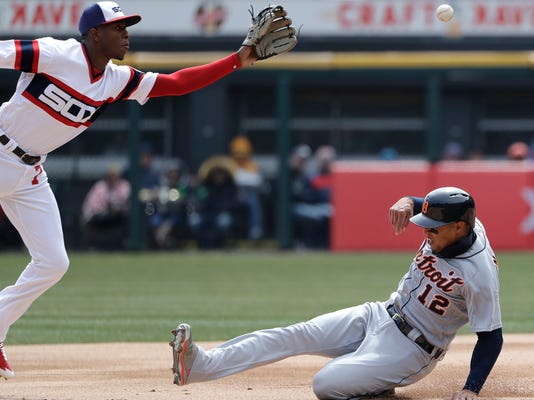 Detroit Tigers' Leonys Martin, right, steals second base as Chicago White Sox shortstop Tim Anderson tries to catch the ball during the first inning of a baseball game Sunday, April 8, 2018, in Chicago. (AP Photo/Nam Y. Huh)