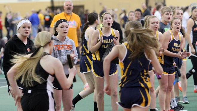 Iowa Valley and Belle Plaine teammates cheer on their respective teammates in the 4x800 at the WaMaC indoor meet held Monday, March 21, at Grinnell College.