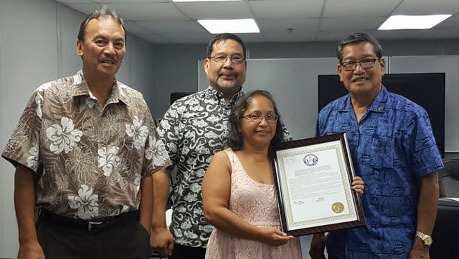 Congratulations to Victoria M.P. Cepeda on her well-earned retirement after 32 years of service in our local government. She has worked at various agencies serving the people of Guam since 1979. She wraps up her long career at the Dept. of Revenue and Taxation with a legislative resolution from Sen. Joe S. San Agustin. From left: Rev and Tax Director John Camacho, Deputy Tax Commissioner Paul Pablo, Cepeda and San Agustin.
