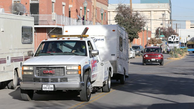 A tow truck Wednesday carries away the camper that was being used by community activists keeping watch over buildings in Duranguito to prevent further demolition. One woman was arrested after she tried to block the tow truck.