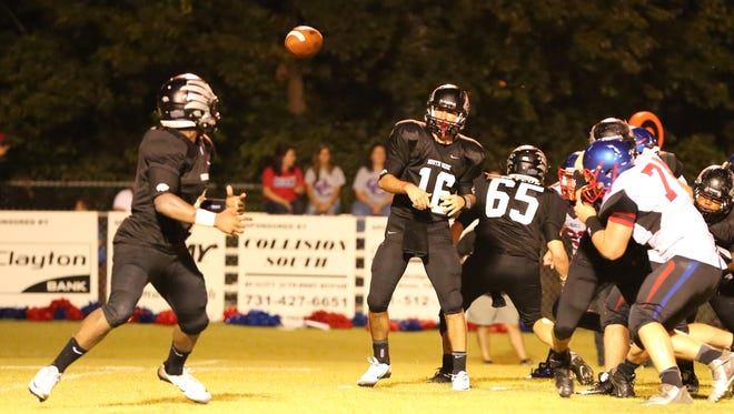South Side quarterback Cade Willingham throws a slant pass to Tariq Robinson in Week 1.
