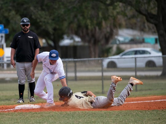 Canterbury third-baseman Tyler Shuck tags out a Moore Haven player on Tuesday at Rutenberg Park in south Fort Myers.