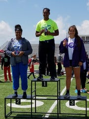 Lake View's Mya Lindsey, left, on the awards stand for a second-place finish in the girls shot put Friday, April 21, at the Districts 3/4-5A Area Track and Field Championshps in Canyon.