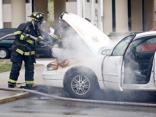 Elmira firemen extinguished a car fire Tuesday in the