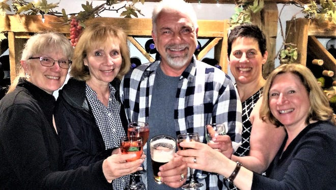 """Joe Gober, of Americana Vineyards Winery, celebrates with members of the Ulysses Philomathic Library's """"Libations for the Library"""" annual fundraising event. From left are Kathy Bond, Mary Kaszyca, Wendy Tarlow and Cynthia Mannino."""