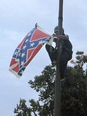 Bree Newsome of Charlotte, N.C., removes the Confederate