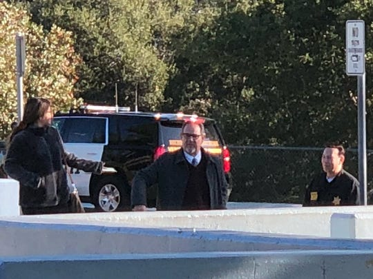Westlake High school officials and Thousand Oaks police were outside Westlake High School on Friday morning after graffiti was found Thursday in a girls' restroom that implied violence.