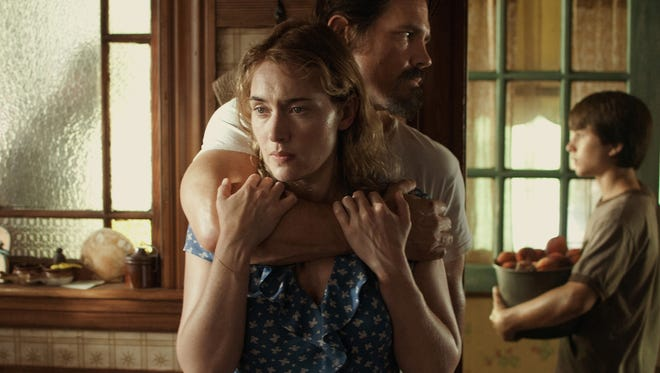 Kate Winslet as Adele, Josh Brolin as Frank and Gattlin Griffith as Henry in a scene from 'Labor Day.'
