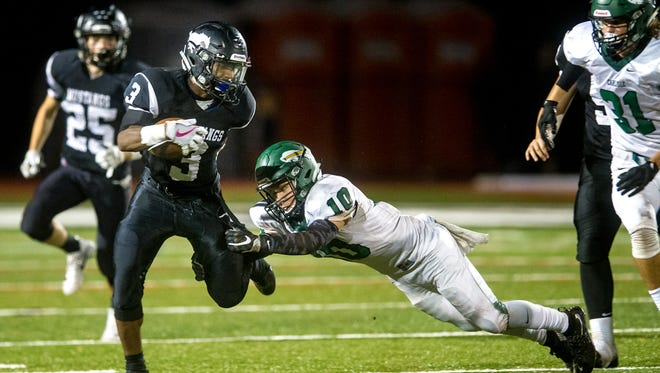 South Western's Delunche Shaw (3) shakes off Carlisle's Noah Costopollus (10) in a PIAA District 3 Football game on Friday, Sept. 15, 2017. Carlisle won 28-19.
