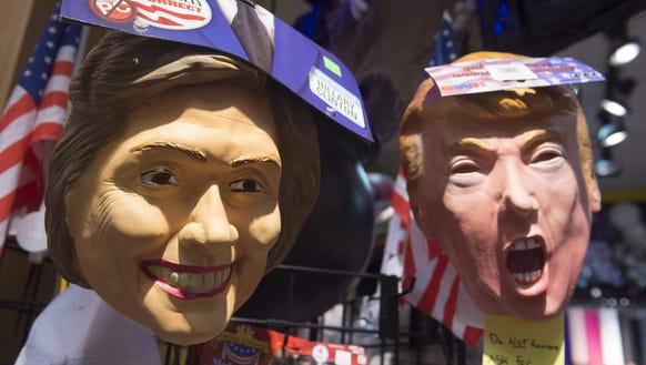 Halloween masks depicting Hillary Clinton and Donald