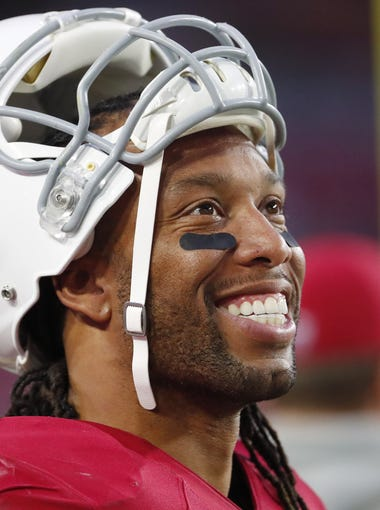 Arizona Cardinals wide receiver Larry Fitzgerald (11) watches the final minutes during the fourth quarter against the New York Giants at University of Phoenix Stadium in Glendale, Ariz. December 24, 2017.