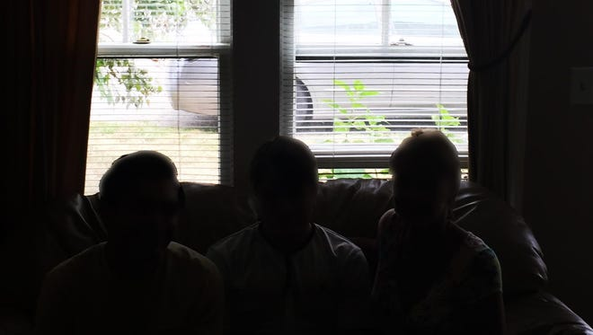 """A Morris Township family, shown here in silhouette to protect their identity, recently fell victim to what police described as an """"unusually sophisticated""""~ phone scam."""