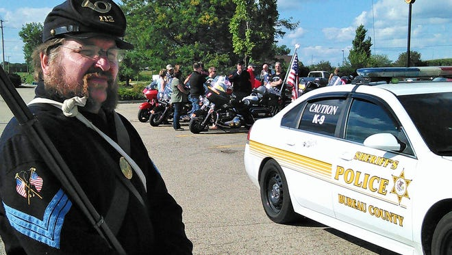 A group of Patriot Guard Riders in Illinois met a contingent of their motorcycle-riding peers coming from Iowa, respectfully transporting the remains of a Civil War veteran across the nation.  Among them was Mike Sullivan, shown here in his authentic Union soldier's uniform.