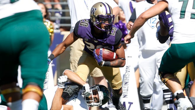 Washington defensive back Kevin King intercepts a pass against Sacramento State on Sept. 12, 2015.