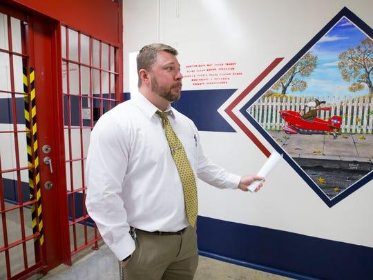 CoreCivic Florence Complex warden Kris Kline walks