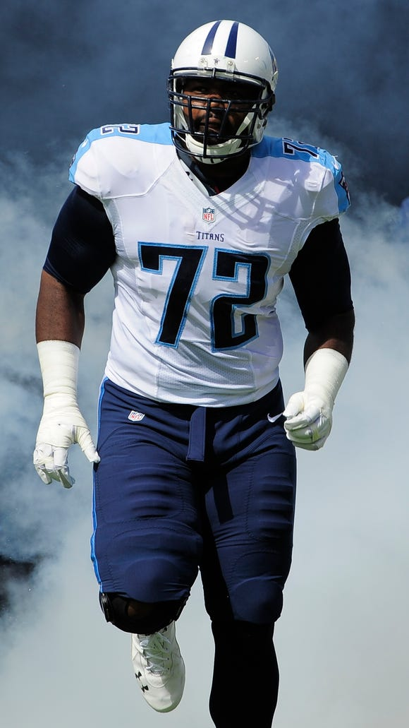 FILE: Michael Oher, then a Tennessee Titan, races out