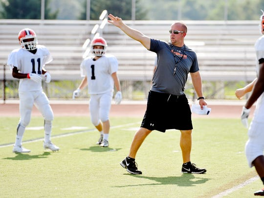 Central York's new head football coach Josh Oswalt gives directions to players Thursday, Aug. 18, 2016, during practice. This is the Panthers' first football season in 34 years without former coach Brad Livingston at the helm. Livingston, who had been part of the program for 46 years, was fired at the end of the school year. Josh Oswalt, coming from Carlisle, was recently hired for the head coach position.
