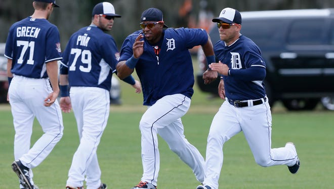 Tigers outfielder Yoenis Cespedes, center, is excited to play with fellow Cuban import Jose Iglesias, right.