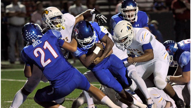 Cougar running back Maurice Johnson drives for the goal line to make a touchdown during Cooper High School's game against Frenship High School Friday Sept. 22, 2017. Cooper won, 62-3.