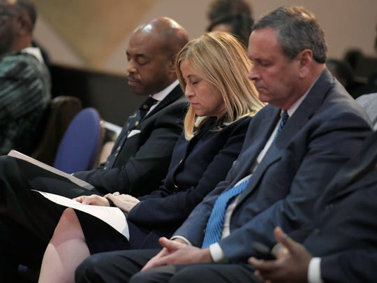 Pastor and state Rep. Harold Love, left, Mayor Megan Barry and District Attorney Glenn Funk pray during a service for the city and the Jocques Clemmons family at Mt. Gilead Missionary Baptist Church on Thursday, May 11, 2017.