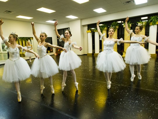 """Snowflakes played by (from left) Emily Baer, Sarah Jones, Emma Stevens, Kerrie Williams and Alena Nead during dress rehearsal for """"The Nutcracker"""" in 2014 at the Children's Center for Dance Education."""